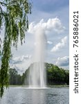Small photo of Beautiful park landscape in the city park of Halle Saale with huge water fountain