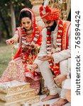 indian bride and groom dressed...   Shutterstock . vector #765894424