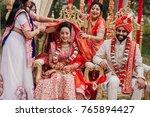 women put a cloth on indian...   Shutterstock . vector #765894427