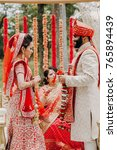 indian groom dressed in white... | Shutterstock . vector #765894439
