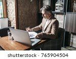 businessman sitting at cafe and ... | Shutterstock . vector #765904504
