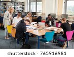 busy college library with... | Shutterstock . vector #765916981