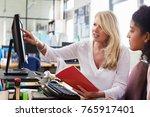 careers advisor meeting female... | Shutterstock . vector #765917401