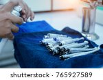 the nurse is cleaning the... | Shutterstock . vector #765927589