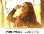 autumn woman portret   Shutterstock . vector #76593973