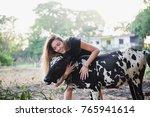the girl hugs the cow | Shutterstock . vector #765941614