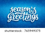 seasons greetings lettering on... | Shutterstock .eps vector #765949375
