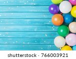 Balloons and confetti border....