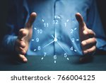 Small photo of Businessman showing clock. Concept of saving time.