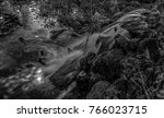 Small photo of small waterfall in manlius new york shot in black and white