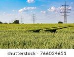 high voltage power line along a ... | Shutterstock . vector #766024651