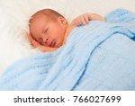 sleeping newborn baby | Shutterstock . vector #766027699