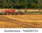 green tractor pulling a red... | Shutterstock . vector #766030714
