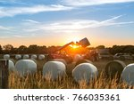 Tractor Transships Bales From A ...