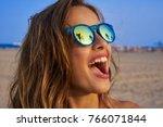 brunette girl on beach... | Shutterstock . vector #766071844