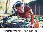 push ups. young muscular... | Shutterstock . vector #766135201