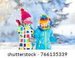 kids playing in snow. children... | Shutterstock . vector #766135339