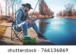 fisherman angling on the river. ... | Shutterstock . vector #766136869