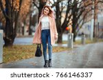 beautiful fashion girl walk on... | Shutterstock . vector #766146337