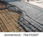 MALACCA, MALAYSIA -JULY 26, 2016: The wet concrete poured on a steel reinforcement bar to form strong floor slabs called reinforce concrete floor slab.  - stock photo