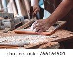 the carpenter in the workshop...   Shutterstock . vector #766164901