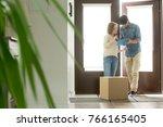 young woman receiving cardboard ... | Shutterstock . vector #766165405