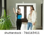 real estate agent showing house ... | Shutterstock . vector #766165411