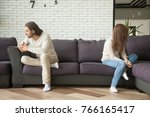 unhappy sad couple sitting... | Shutterstock . vector #766165417