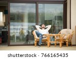 young calm man relaxing sitting ... | Shutterstock . vector #766165435