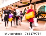 motion blurred female shoppers... | Shutterstock . vector #766179754
