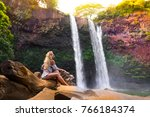 alone traveler woman seats with ... | Shutterstock . vector #766184374