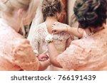 bridesmaid preparing bride for ... | Shutterstock . vector #766191439