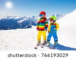 child skiing in the mountains.... | Shutterstock . vector #766193029