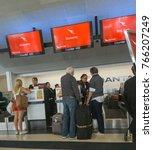 Small photo of AUCKLAND, NEW ZEALAND - NOVEMBER 23; People checking in and getting seat allocation at Qantas counter with bags ready to travel November 23, 2017 Auckland New Zealand