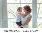 young mother holding her child. ... | Shutterstock . vector #766217239