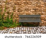 a bench in front of a stone... | Shutterstock . vector #766226509