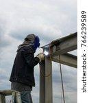 technician welding steel... | Shutterstock . vector #766239589