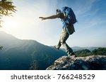 brave woman hiker walking to... | Shutterstock . vector #766248529