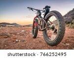 fat bike on desert trail with... | Shutterstock . vector #766252495