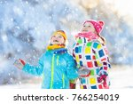 kids playing in snow. children... | Shutterstock . vector #766254019