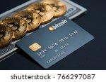concept bank card bitcoin on a... | Shutterstock . vector #766297087