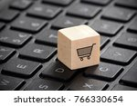 wooden block with shopping cart ... | Shutterstock . vector #766330654