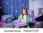 a girl and a gift in the new... | Shutterstock . vector #766347229