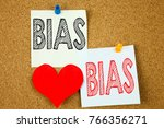 Small photo of Conceptual hand writing text caption inspiration showing Bias concept for Prejudice Biased Unfair Treatment and Love written on sticky note, reminder cork background with space