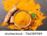 curcuma  powder and root | Shutterstock . vector #766389589
