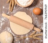 raw dough with rolling pin | Shutterstock . vector #766390969