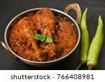 Small photo of Top view Lagan ka murg drumstick chicken curry roast hot and spicy gravy dish Hyderabad, India. South Indian non-vegetarian cuisine prepared use Garam Masala. Popular side dish for chapati, rice.