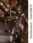 themis  gavel  book. law
