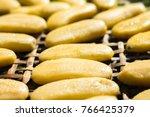 dry banana on the bamboo basket.... | Shutterstock . vector #766425379