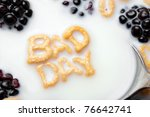 A bowl of alphabet cereal pieces floating in milk with the words BAD DAY spelled out. - stock photo